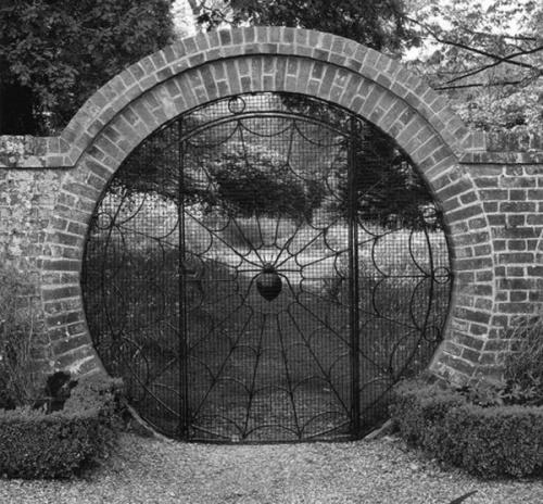 spider-garden-gate-web-hoveton-hall-gardens